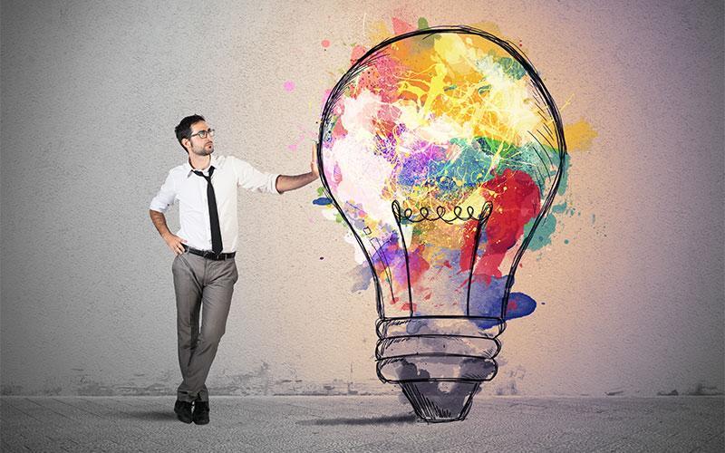 Man leaning on lightbulb